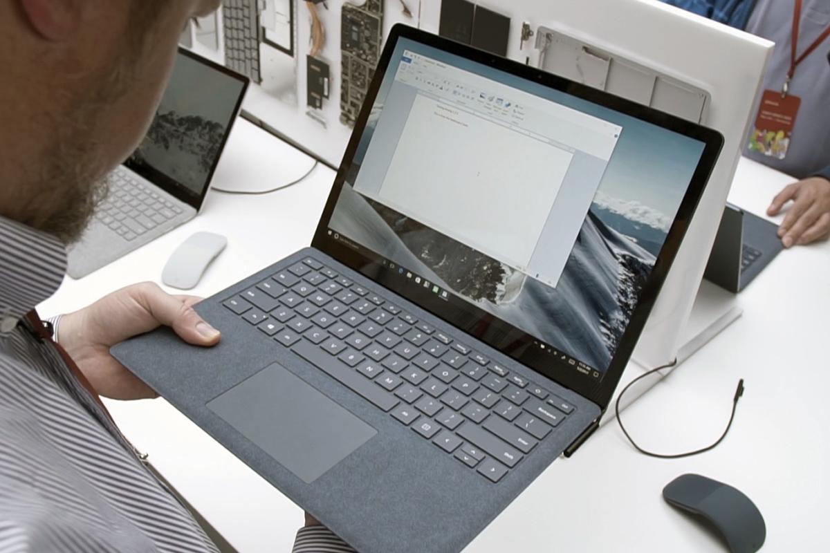 surface laptop holding