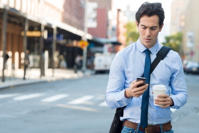 thinkstock guy checking iphone email