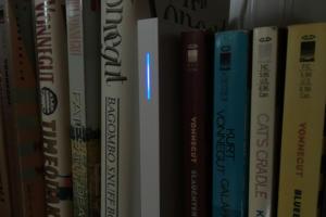 Wink Hub 2 on a bookshelf