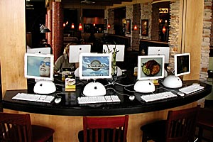 Schlotzsky•s customers can use their own laptops (top) or the restaurant•s computers to surf the Internet for free.