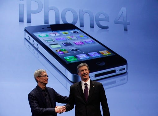 Apple Chief Operating Officer Tim Cook shakes hands with Verizon Wireless president and CEO Dan Mead