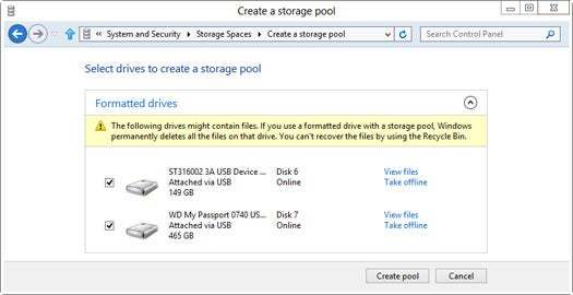 Windows 8's Storage Spaces automagically combines multiple disks into one