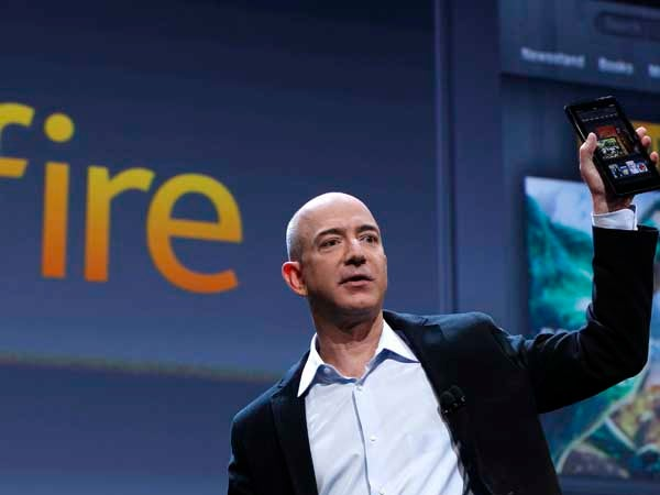 Amazon CEO Jeff Bezos holds up the new Kindle Fire