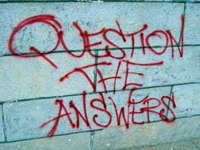 Graffiti on a wall that reads 'Question the answers'