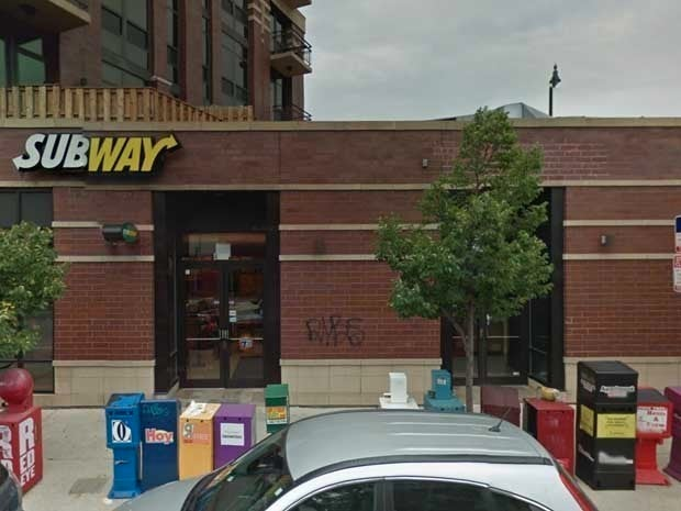 Exterior picture of a brick building with a Subway restaurant