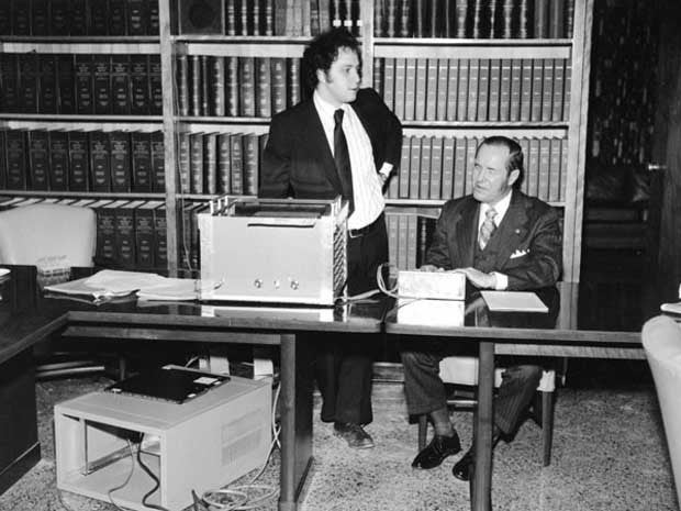 Photo of Ray Kurzweil and Kenneth Jernigan, Demonstrating the Kurzweil Reading Machine, Director's Conference Room, Iowa Commission for the Blind, 1977