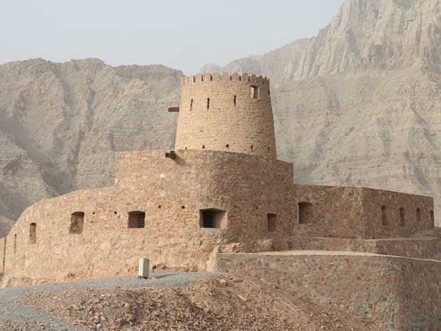 Fort at the top of a small foothill in Tibat, Oman