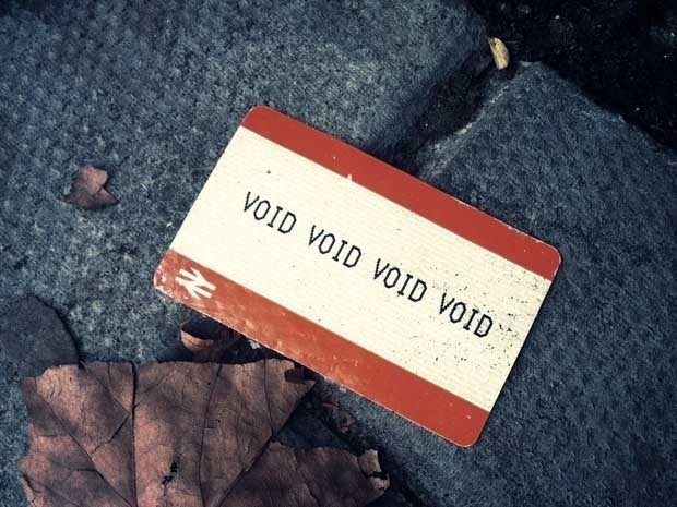 Picture of a sticker on the ground that reads Void Void Void