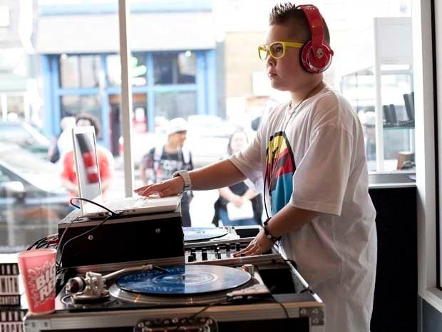 A picture of a DJ spinning and scratching records on a turntable