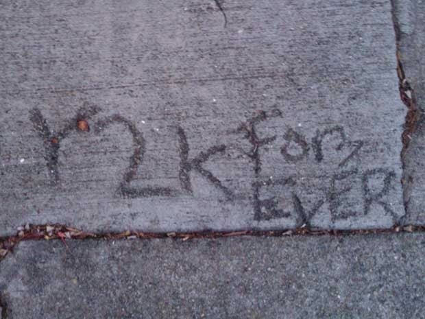 Graffiti on a sidewalk that reads Y2K Forever