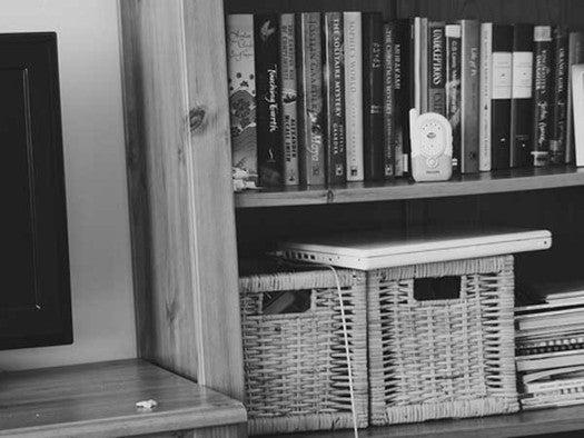 baby monitor on bookshelf