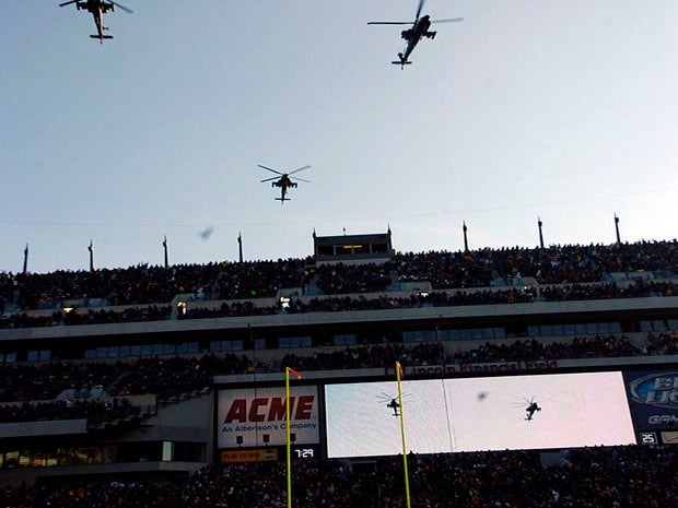 Helicopters flying over football game