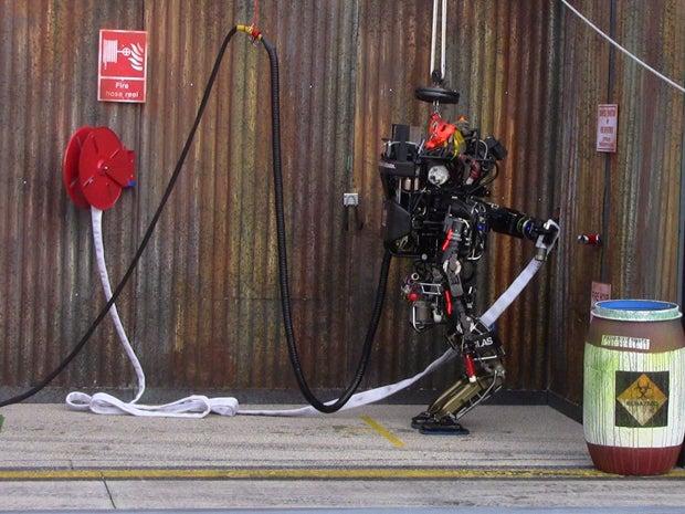 Warner robot pulls hose