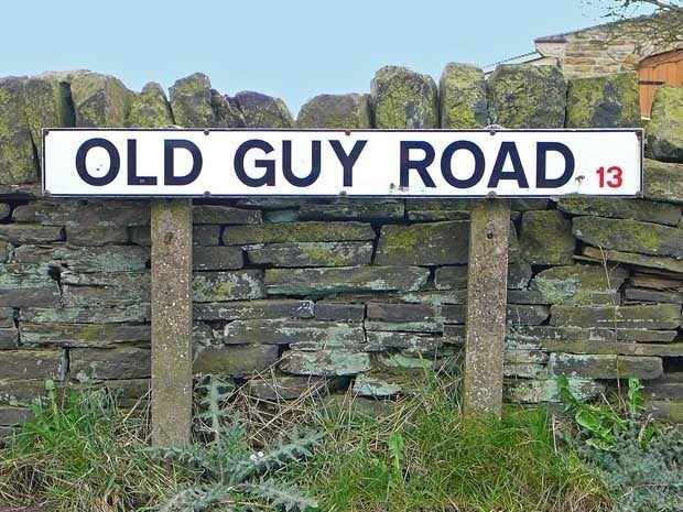 Street sign that says Old Guy Road