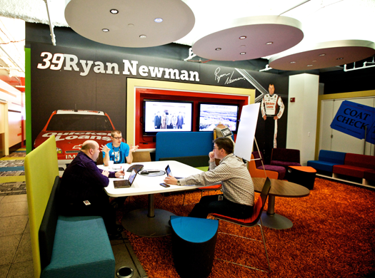 office lobby showing NASCAR driver and car