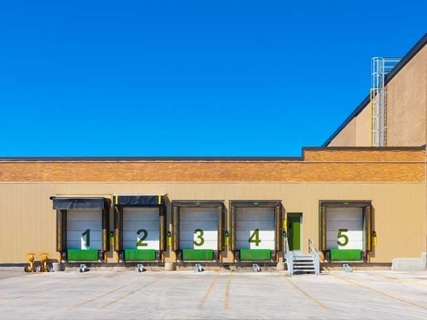 Garage doors numbered 1, 2, 3, 4, 5