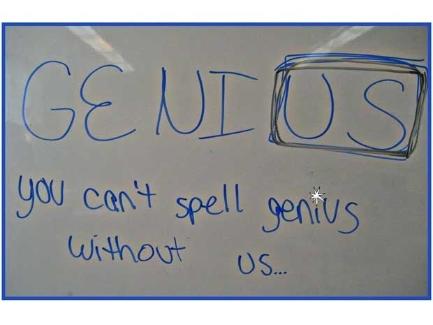 A whiteboard with the words Genius You Can't Spell Genius Without US