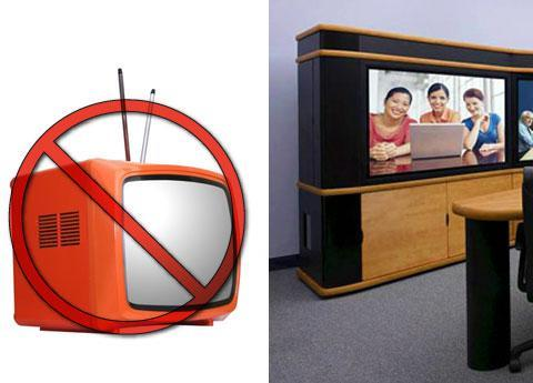 Image of an small old TV with rabbit ears Xed out next to a huge color monitor with an attractive pe