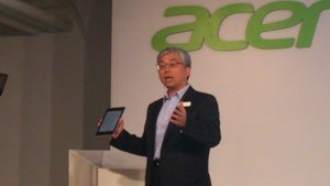Acer chairman Jim Wong showing the $169 Iconia A1 Android tablet